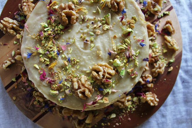 Raw Carrot Cake with cream cheese frosting, pistachios and walnuts